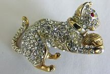 costume jewelry: cats and dogs / by Sheila Troppe