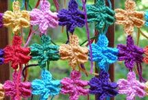 Six-petal flower shawls / Some shawls I am making for my mother's long-lost cousins / by Crochetbug