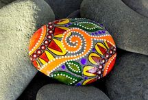 Painted Pebbles / The art and design of decorating stones... See my website http://www.dreamingaloud.net/ decorated with colourful pebbles. / by Lucy Pearce