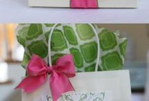 Great Gift Wrapping Ideas.. / Gift wrapping is the act of enclosing a gift in some sort of material. Wrapping paper is a kind of paper designed for gift wrapping. Gifts may also be wrapped in a box. They may be held closed with ribbon and topped with a decorative bow (an ornamental knot made of ribbon).