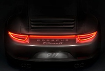 The taillight strip of the all new 911 Carrera 4 / We are proud to announce that the all new 911 Carrera 4 models will be available soon. To shorten the waiting time, join our Pinterest action by doing this: chase any Porsche 911 with taillight strip, take a photo and pin it in this board. All photos pinned in this board will be used to create a unique piece of art that will be displayed in the Porsche Museum in Stuttgart. Please upload your photo therefore in high resolution. Please consider the terms and conditions: http://tinyurl.com/9zbovln / by Porsche