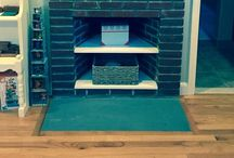 Fireplace Repurposed in kids room / There's an unused fireplace in the girls' room. What can be done to make it useful?