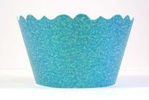 Glitter Cupcake Wrappers & Glitter Cupcake Holders / Looking for a fun way to add a sparkle to your cupcakes? These Glitter Cupcake Wrappers will add the Glitz & Glamor that your guests will admire. It's easy to add a touch of elegance with these glitter cupcake holders. Just bake or buy your cupcakes and set inside one of our Glitter Cupcake Wrappers. www.bellacupcakecouture.com