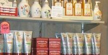 Shop here for bee and honey themed items / We carry Savannah Bee Company products such as  lotions,  royal butters, and body wash. We also carry bee and honey themed candles, towels, and handmade pottery honey pots, and jars.