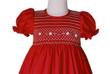 Girls Red Dresses / Beautiful hand smocked girls red dresses specially for Portraits, Parties, special occasion and portraits during the holidays and Christmas with Santa.  These beautiful dresses are perfect for her first birthday and are made with care and attention to the simplest detail!