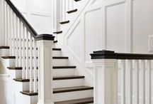 Staircase / Square baluster with square spindles.  Black/Ebony railings against dark floors.  Future: possible molding against wall.  Runner: Something similar to Stark Diamond Sisal but is cleanable and durable.