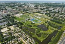Nelson Mandela Park (Amsterdam, the Netherlands) / Urban design for a park with 700 dwellings and 10 ha sports program, offices and school.
