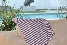 """Towels - Beach Candy! / This Turkish bath towel is an absolute favorite of everyone! This fabulously airy, thinly striped Turkish-T has become our """"grown-up, take everywhere, securtiy blanket""""! Made of 100% loomed Turkish cotton, you will never want to leave home without yours!"""