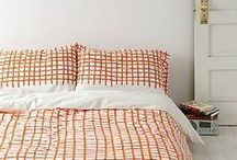 | m e | HOME | bed - orange | / This is my inspiration for adding some color (orange) to our plain white bedroom. Although I don't want to loose the tranquility of white. So a little pop of color goes a long way.