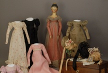 Petite Trousseau / There is just something appealing about  a doll and her tiny wardrobe. / by Dawn Smith