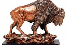 Buffalo Statues / Create a beautiful focal point in your home and bring an exciting look to your decor with these striking buffalo statues.