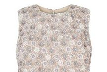 Sequin Daisy Bodice Top / SUZANNAH Sequin Daisy Bodice Top.  Fully beaded silk based statement top. Sequinned design in a beautiful daisy pattern in tones of pink, ice blue, ivory and pearl. The colourway and design have a subtle late 1950's early 1960s reference. A chic exclusive top designed to be worn with our 1950s Influenced Cocktail skirt..x   http://www.suzannah.com/ready-to-wear/skirts/sequin-daisy-bodice-top.aspx