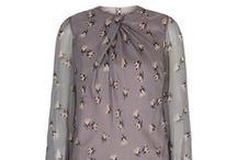 Charming Blouse / SUZANNAH Charming Blouse.  Beautiful Italian silk chiffon blouse with vintage inspired boat print in peaches, Ivory and charcoal onto a sensitive pearl grey base. The blouse is individually tailor made and french seamed. A silk satin lining is sewn into the bodice part whilst the sleeves remain unlined. The cuffs are elongated. Silk covered buttons close the cuffs and the back neck keyhole. http://www.suzannah.com/ready-to-wear/skirts/grey-silk-printed-beautiful-blouse.aspx