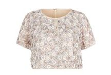 Sequin Daisy Tee Shirt / SUZANNAH Sequin Daisy Tee Shirt.  Fully beaded silk based statement tee shirt. All-over sequinned design in a beautiful daisy pattern in tones of pink, ice blue, ivory and pearl. The colourway and design have a subtle late 1950's early 1960s reference. A chic exclusive top designed to be worn with our 1950s Influenced Cocktail skirt..x   http://www.suzannah.com/ready-to-wear/skirts/sequin-daisy-bodice-tee-shirt.aspx