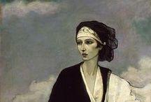 Romaine Brooks / Romaine Brooks, née Beatrice Romaine Goddard, à Rome le 1er mai 1874 et morte à Nice le 7 décembre 1970, est une peintre américaine.  Essentiellement composé de portraits, avec une palette sombre dominée par les gris, son œuvre est proche des mouvements symboliste et esthétiste du xixe siècle, et particulièrement des travaux de Whistler. Quatre de ces portraits sont visibles dans les collections du Musée Sainte-Croix à Poitiers.