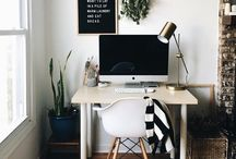 workspace / Wooden desks, white walls and comfy chairs.