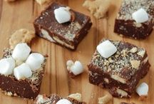 S'mores galore / Every smores recipe imaginable.. from traditional campfire smores to bars, cakes, desserts, cupcakes, truffles, milkshakes, icecream and more. Graham Cracker, Chocolate and Marshmallow... What's not to LOVE?