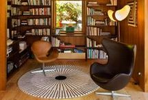 Books and Chairs / Leather seating in a room of books.