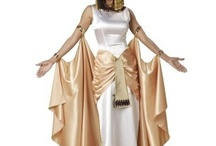 Egypt Costumes / The beautiful Egyptian Collection Women's Costumes shimmer with gold and satin and the men's feature leatherette tunics, arm bands, leg guards, and capes. Accessories include braided wigs, sandals, jewelry and of course, swords. There's something for everyone including plus sizes.