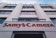 In-Store with Samy's Camera / Samy's Camera has been the leading provider of cameras and other imaging equipment to the Los Angeles area since 1976. Serving both professional and amateur photography communities through sales and rentals from six traditional store fronts in LA, Pasadena, Culver City, Santa Barbara, Santa Ana and now in San Francisco, there is rarely a dull moment! We've managed to capture a few of our favorite in-store and Samy's Camera staff moments.