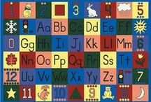 Rugs for Classrooms & Kid's Rooms / Colorful rugs that serve to delight and instruct at the same time. / by Davia Bailey