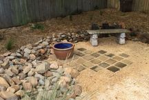 Sunken garden / An old in-ground pool space rejuvenated into a sunken garden using rocks and sleepers