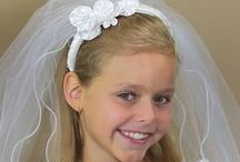 First Communion Apparel / First Communion dresses and veils plus a few accessories for the girls...