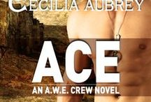 """ACE - The A.W.E. Crew Book 1 / The A.W.E Crew's expert sniper, Lt. Cameron """"Ace"""" Acer is married to the military. An injury sustained in a high profile mission may spell the end of active duty in a career he loves. Quitting is not an option. His only hope lies in Olivia Briggs, his physiotherapist, whose gentle hands heal not only his wounded body but his savaged heart."""