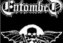 Entombed  / Entombed is a Swedish death metal band which formed in 1987 under the name of Nihilist. Entombed began their career as an early pioneer of Scandinavian death metal. However, by the early 1990s their sound had broadened to include garage rock and other influences. This new style would eventually be described as death 'n' roll. Entombed have been influenced by bands such as Autopsy, Slayer, Kiss, The Misfits, Motörhead & Discharge.