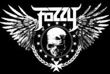 "Fozzy / Fozzy is an American heavy metal band, formed in Atlanta, Georgia, in 1999. The lead singer of the band is professional wrestler Chris Jericho. Jericho has characterized the band by saying, ""If Metallica and Journey had a bastard child, it would be Fozzy."""