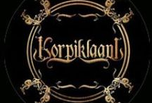 Korpiklaani / Korpiklaani (Finnish: Wilderness Clan) is a folk metal band from Finland who were formerly known as Shaman, formed in 1993.