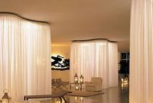 Design Details: Drapery as Walls / Taking the window treatments onto the walls can help create a wall where there isn't one.. add a sense of sensuality and comfort, as well as correct the lack of symmetry on a wall or create a backdrop for an important design statement. These are a few that inspired my posts..