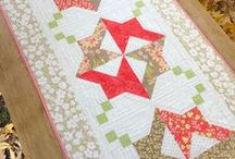 Tablerunner Bliss Quilt Along / Welcome to the Tablerunner Bliss Quilt Along! Each week for 10 weeks, we will be debuting 2 tablerunners made by our amazing quilters! Get your copy of The Tablerunner Bliss Book here: https://goo.gl/mo5b7G