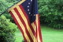 Primitive Flags & Bunting / Our Tea Stained, primitive American Flags and Buntings are made of 100% Heavy Cotton. The Stars are embroidered & the Stripes are stitched. Tea stained directly from the factory to hold up over time and maintain their old, time-yellowed appearance.