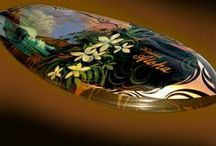 Hand-Painted Surfboards / Wade Koniakowsky paints images of the tropics and other ocean-related lusciousness on surfboards, then they are glassed and prepared for display.