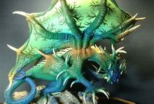 Dragons: Mixed media / Metal, wire, glass, clay, beads, steampunk and public statues, just combining some of my other boards