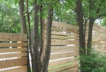 Privacy for a Chain Link Fence / Solutions for adding privacy to a chain link fence -- with fence slats or tarps, or with trees and shrubs