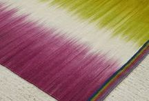Collaboration: Ptolemy Mann / Ptolemy Mann has been designing colourful textiles from her studio since 1997. Her architectural, geometric and sophisticated wall based art is designed for public and private clients using her signature hand dyed and woven techniques.   After working with Copper & Silk on Channel 4 television program Monty Don's Real Craft Ptolemy collaborated with our team to create an exclusive range of modern ikat fabrics which we have transformed into handmade custom lampshades.