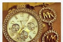 Michael Kors / Sleek Jewellery and Watches by Michael Kors provide a contemporary edge with a touch of jet-set glamour.