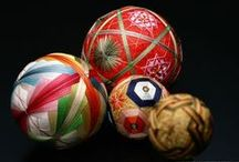 """Crafts - Temari Spheres / """"Temari balls are a form of folk art that originated in China and were introduced to Japan in the 7th century. The carefully hand-embroidered balls often made from the thread of old kimonos were created by parents or grandparents and given to children on New Year's day as special gift. According to Wikipedia the balls would sometimes contain secret handwritten wish for the child, or else contained some kind of noise-making object like a bell."""""""
