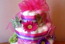 Diaper Cakes (how to and inspiration) / Baby showers and first birthday parties....diaper cakes are fun and impressive gifts and decorations. / by Laura Hiller