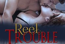 """REEL TROUBLE - Book 1 in the Wild Women of Alaska Series / A man satisfied with his """"catch and release"""" type of dating, until he meets the strong-willed woman he can't throw back."""