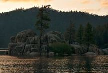 Romantic Vacations / Big Bear Lake is a unique place to enjoy a romantic vacation. Take a sunset hike, massages by the lake or at your cabin, take in the winter snow backdrop right here in Southern California.