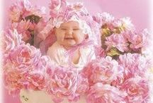 """Anne Geddes / Australian born Photographer known for her  """"Stylized Depictions of Babies & Motherhood.""""."""