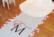 Wedding Aisles / We love seeing a decorative wedding aisle. Some of our favorites include a personalized wedding aisle runner, flower petals, pew bows and more.