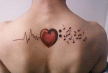 tattoos and piercings.  / by Sophy Cudnik