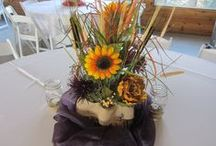 Centerpieces / Centerpieces vary from wedding to wedding.  Candles are so romantic and look wonderful after dark at the Farmhouse.