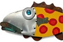 Fantasy Fish Wall Art / The Fantasy Fish are made from recycled materials by Artist, Lisa Pirkle. The body is made from recycled wood, the head is aluminum, the fins are steel, the lips are copper and the eyeball is a can lid with a bottle top and marble. Fantasy Fish come in a variety of viibrant coastal colors and ready to hang on your wall.