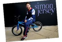 Road to Rio   Simon Jersey / Simon Jersey was announced as an official supplier to Team GB in Autumn 2014. We are set to supply the team with uniforms for the Rio Olympic Games this summer where the athletes will wear our designs in the closing parade which is set to be watched by almost 1 billion people worldwide. We will also provide the full team with suiting which they will wear to formal events both in the UK and Rio.