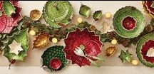Julia Knight | Poinsettia Collection / The Poinsettia Collection will add a beautiful arrangement of rich reds, gorgeous greens and marvelous metallics to your holiday table. Each piece is individually hand-made of sand cast aluminum -which is sculpted, polished and finished with a proprietary blend of enamel mixed with crushed mother of pearl powder that is hand painted to form unique capiz-like swirls. Mix and match or layer in pieces from Julia Knight's Holly Sprig, Diamond or Peony Collections to make a stunning statement!